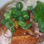 Asian broth with smoked duck and wontons