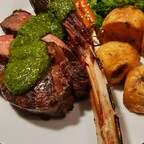 Reverse seared tomahawk with chimichurri.